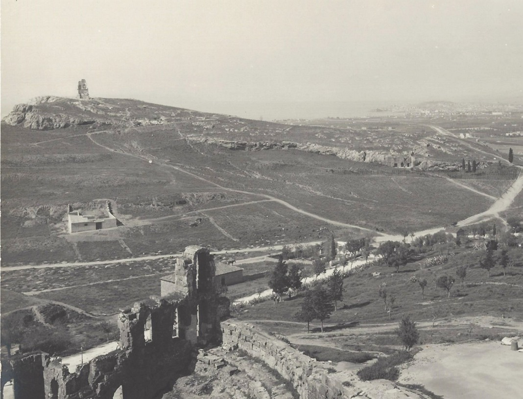 Panoramic view of Philopappos hill from the Acropolis. Piraeus is shown in the background. Neue Photographische Gesellschaft A. G. Berlin Steglitz 1905.